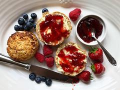 Food   Scones   Gluten Free (Allkitchencolours) Tags: scones englishscones creamtea breakfast dessert glutenfree baking foodphotography whitebackground strawberries blueberries strawberryjam food recipe