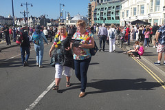 Carrying a face mask (kevin Akerman) Tags: carrying elvis festival mask street garland porthcawl women walking