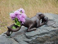 Predator with Flowers (mikecogh) Tags: adelaide parklands statue bouquet flowers fake pretend bunch predator bum butt behind