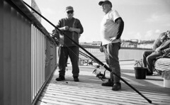 Patience (4foot2) Tags: fishing anglers hastingspier hastings fish rods people peoplewatching interestingpeople candid candidportrate shootfromtheknee zonefocus guess analogue film filmphotography 35mmfilm 35mm 35mmf2 35mmf2summicron summicron leica leicam3 m3 mono monochrome bw blackandwhite rangefinder rolleiretro400s rolleiretro hc110 kodakhc110 kodak 2018 fourfoottwo 4foot2 4foot2flickr 4foot2photostream