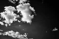 Bird on the wire (iamunclefester) Tags: vacation holiday croatia krk otokkrk baška blackandwhite monochrome sky clouds cloudscape sunny power cable bird wire single solo lonely lonesome one line cord overhead overheadline overheadpowerline up