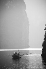 Ha Long Bay (Vịnh Hạ Long) (www.holgersbilderwelt.de) Tags: halongbay vietnam unescoworldheritagesite fishing nature beautiful white light sky water black travel people landscape sea morning art fall sunrise ocean reflection autumn island plant coast outdoor monochrome way shadow amazing weather scenic silhouette tranquility culture calm traditional perspective waterscape schwarzweiss delightful nationalpark valley aperture asia pacific gulfoftonkin
