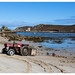 Bryher tractor and Cromwell's Castle, The Scilly Isles, UK
