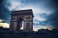We made the world believe (.KiLTRo.) Tags: kiltro arcdetriomphe fr france paris city street champsélysées flag cars urban architecture clouds sky