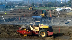 (Rich T. Par) Tags: pomona phillipsranch socal southerncalifornia losangelescounty lacounty constructionsite california tree suburb dirt civilengineering tubes pipes tractor civilengineers heavyequipment constructionvehicles steamroller roadroller frontloader