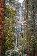 Yosemite Falls through Pine Trees Snow! Nikon D850 Yosemite National Park Winter Snow Fine Art California Landscape Photography! Nikkor 28-300mm Zoom Lens from Nikon. Yosemite Winter Snow Valley View Fine Art! High Res 4k 8K! Elliot McGucken (45SURF Hero's Odyssey Mythology Landscapes & Godde) Tags: nikon d850 yosemite national park winter snow fine art california landscape photography nikkor 1424mm wide angle f28 zoom lens from valley view high res 4k 8k elliot mcgucken parks snowstorm