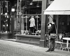Street Photographer at Work (Bury Gardener) Tags: monochrome mono burystedmunds bw blackandwhite britain england eastanglia uk people peoplewatching folks nikond7200 nikon english 2019 streetphotography suffolk street streetcandids snaps strangers candid candids abbeygatestreet