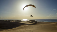 Flying over Dunes of Maspalomas (A1ik) Tags: paragliding parachute sky sport paraglider fly sunset sea flying extreme beach air adventure flight blue paraglide freedom ocean water kite activity sports high wind gliding desert dune send summer heat hot tourist canary