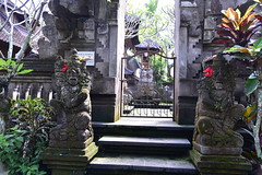 Family temple on the premises of Bliss, Bali (shankar s.) Tags: seasia indonesia java bali islandparadise baliisland touristdestination hotel lodgings accomodation resort entrance blissubudspaandbungalow ubudbali reception garland statue idol hindufaith hindureligion hinduism prayer shrine garden landscaping familytemple placeofworship