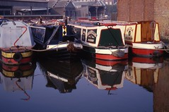 Aylesbury Canal Basin (cycle.nut66) Tags: narrowboat narrow boat boats canal grand union aylesbury arm basin water reflection still red blue yellow colour color colours colors bow stern olympus is1000 bridge camera ed glass high quality 100 hc kodak ekthchrome scan analogue epson 4490 1997 film