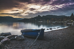 The blue boat and the lake (federicocampolattano) Tags: lake boat blue stone federico campolattano sunset clouds landscape cloudscape water riverbank river germany nikon