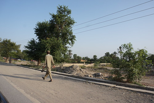 A man walks past a home destroyed by fighting, in North Waziristan, Pakistan's tribal areas.