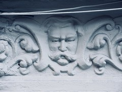 President Taft Like Gargoyle Face Above Doorway 4769 (Brechtbug) Tags: president taft like gargoyle face above doorway building facade 25th street between 7th 8th avenues nyc 11122018 new york city midtown manhattan 2018 gargoyles portraits monster portrait monsters creature faces spooky art architecture sculpture keystone mask brownstone brown stone