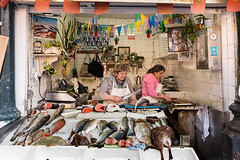 Fish shop (Nino La Corte) Tags: shop counter small business commerce entrepreneur owner ordering woman women fish people street photography market food