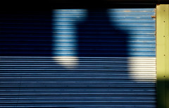 P1010686 (Patrick Hadfield) Tags: shadows corrugated door garage blue