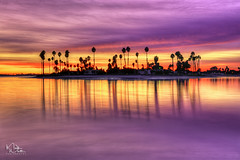 De Anza Cove Colors (markwhitt) Tags: markwhitt markwhittphotography missionbay deanzacove california californiacoast southerncalifornia sandiego water ocean sea cove bay sunset colors colorful clouds trees palmtrees reflections outdoors scenic scenery landscape nature