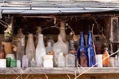 Hidden Treasures (O.S. Fisher) Tags: bottles containers dilapated dusty glass glassware old rundown rustic soda vintage