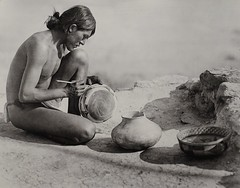 """""""The Pottery Maker, Navajo"""" by Roland W. Reed. (ca. 1915) (lhboudreau) Tags: nativeamericans nativeamerican americanindian vintagephoto vintagephotograph vintagephotography rolandreed monochrome blackandwhite blackwhite rolandwreed pictorialist focus lighting image reed indian photo antiquephoto people indigenouspeople indigenous bw potterymaker thepotterymaker navajo pueblo pottery potter vase vases potterymaking 1915 1913 puebloindian"""