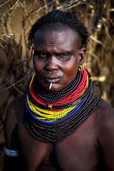 Nyangatom woman - Ethiopia (Steven Goethals) Tags: ethiopia ethiopie ethiopië etiopia tribe tribal portrait girl ethnic nice beautiful ethnology ethnique culture tradition tribo face tribes visage travel human explore east africa people peoples adventure black skin afrique de lest valley goethals steven lokatepan nyangatom necklace westomo colorful kangate fuji fujifilm xseries xt2 xf56