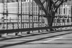 Shadows on Hacker Bridge (suzanne~) Tags: bicycle hackerbrücke bike fence munich germany bavaria blackandwhite bw bridge lensbaby sol45