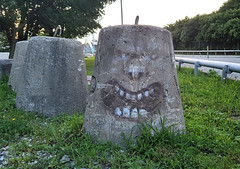 Angry Block of Concrete (Coastal Elite) Tags: angry face block concrete montreal painted teeth grin mouth graffiti paint streetart urban street art funny menacing anger mill griffintown montréal barrier heavy industrial béton