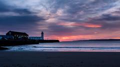Sunrise over South Bay (Derwisz) Tags: scarborough yorkshire england beach sea seaside seafront seascape sunrise clouds lighthouse bay southbay colour color canoneos40d englandseastcoast coast lowlight landscape