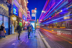 Night Bus - West End, London, UK (davidgutierrez.co.uk) Tags: london photography davidgutierrezphotography city art architecture nikond810 nikon urban travel color night blue photographer tokyo paris bilbao hongkong uk londonphotographer telephonebox skyscraper twilight bluehour colors colour colours colourful vibrant england unitedkingdom 伦敦 londyn ロンドン 런던 лондон londres londra europe beautiful cityscape davidgutierrez capital structure britain greatbritain ultrawideangle afsnikkor1424mmf28ged 1424mm d810 arts landmark attraction historic iconic icon touristattraction phonebox redphonebox street people person westminster colorful chinatown westend shaftesburyavenue centrallondon nightbus busstop lighttrails