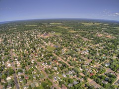 Aerial View of the Small Town of Ashland, Wisconsin on the Shore of Lake Superior (JacobBoomsma) Tags: background nature landscape travel view sky fall islands grass northwest wagner ashland park tourism forest scenic sunset blue lake island small beauty lakefront wisconsin sun late tree lakesuperior county wet beautiful summer water trees land outdoor autumn point clear light aerial drone plane city town