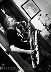 Marko Novachcoff [50D-1893GS] (Juan N Only Music Photos) Tags: music jazz freejazz boxdeserter bohemianhomeinexile cafe lepetitzinc detroit michigan grayscale blackwhite monochrome baritonesaxophone saxophone improvisation avantgarde creative experimental may 2010 juannonly blackandwhite musician