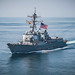 USS Jason Dunham flies the battle ensign and the flag of France.