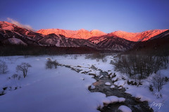 Morning view of Hakuba Miyama river and red mountain. Snow around three mountains of Hakuba Nagano prefecture, Japan. Ushiro-tateyama mountain ranges such as Goryo-dake, Kashima-yarigatake, Jiigatake. (pomp_jaideaw) Tags: mountain japan hakuba snow nagano sky white blue landscape nature alps village ski view winter cold alpine mountains outdoor resort beautiful sunny background sunset high peak holiday goryudake shinshu summer travel space season tourism vacation clouds back top summit climbing sport rock night asia scenic country morning scenery ice