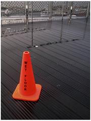 Wet Floor (prima seadiva) Tags: market pikeplace rainy trafficcone