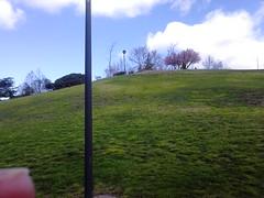 Looking up the hill,   Parque Enrique Tierno Galvan, 1986, Madrid (d.kevan) Tags: parksandgardens madrid parqueenriquetiernogalvan 1986 grass trees plants clouds slopes streetlamps
