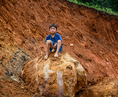 A boy sitting on rock in Sa Pa, Vietnam (phuong.sg@gmail.com) Tags: agriculture asia asian cat child childhood china countryside culture ethnic expression face farm farmer happiness happy hilltribe hmong kid landscape life lifestyle local minority mountain nature oriental pa paddy people plant play poor portrait poverty rice rural rustic sa sapa smile terraces travel tribal vietnam young