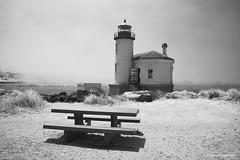 Coquille river Lighthouse - infrared (JSB PHOTOGRAPHS) Tags: dsc590400001bw infrared infraredconvertedcamera bench benchmonday hbm nikon d70 blackandwhite bw happybenchmonday bandon bandonbythesea oregoncoast ocean sea coast summer water