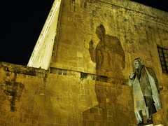 Its not the height of a man that gives the length of his shadow (jpartcore) Tags: nighttime jpartcore night urban statue malta shadow valletta olympus island mediterranean nacht traffic sky dark