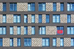 Facade with flag (Jan van der Wolf) Tags: map191383v facade flag rotterdam vlag rhythm visualrhythm herhaling repetition windows ramen gevel architecture architectuur hattabuilding moroccanflag marokko