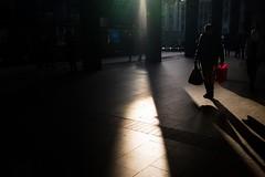 Christmas shopping (donvucl) Tags: london eustonstation euston shadows shadow composition highcontrast redbag colour fujixt3 donvucl
