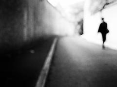 blowing in the wind (Sandy...J) Tags: blackwhite bw blur blurred verschwommen street streetphotography sw schwarzweis strasenfotografie silhouette olympus monochrom light alone city germany walking wall absoluteblackandwhite