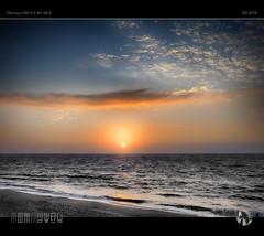 Blowing Away the Cobwebs (tomraven) Tags: sunset sky clouds sun sea ocean coast tomraven coastal aravenimage q42018 olympus em1mk2