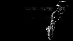 Sun and Sax. (Neil. Moralee) Tags: canadaneilmoraleenikond7100 neilmoralee saxaphone music artist player musician saxophonist sunshine neil moralee nikon d7100 dark black white bw bandw blackandwhite blackbackground hat man mature baker street gerry rafferty solo sax sun toronto canada candid contrast noir film city album busker busking raphael ravenscroft mono monochrome soul jaz jazz blues rock woodwind brass instrument musical