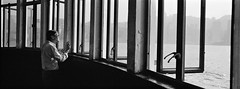 (perryge) Tags: hongkong tsimshatsui starferry windows geometry man candid streetphotography tourist people urban city architecture interior repetition blackandwhite film orientalseagull400 hc110 hasselbladxpan xpan45mm panorama