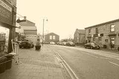 Mirfield town centre.   November 2018. (dave_attrill) Tags: towncentre mirfield mainstreet traffic shops westyorkshire yorkshire kirklees huddersfield sepia november 2018