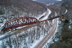 Winter along the Keystone (benpsut) Tags: bridge csxkeystonesub csxq135 drone keystone keystoneviaduct q135 snow wm wmkeystoneviaduct westernmaryland winter aerial aerialphotography dronephotography railroad river trains viaduct