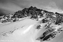 Alpine Snow and Rock (Dave Snowdon (Wipeout Dave)) Tags: davidsnowdonphotography landscape lumixdmctz6 lumix panasonic alps alpine alpes valthorens hautesavoie france francais frenchalps snow winter rocks mountains blackandwhite