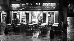 Made in Italy (byronv2) Tags: dusk night nuit nacht edinburgh edinburghbynight scotland oldtown architecture building italy italian italianrestaurant restaurant cobbles cobbledstreet chair table diner peoplewatching street candid blackandwhite blackwhite bw monochrome shop window grassmarket winter weather rain wet