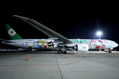 """Eva Air B777-300ER B-16703 """"Hello Kitty"""" parked at TPE/RCTP (Jaws300) Tags: taiwantaoyuaninternationalairport evaair specialcolors specialcolours specialcs canon5d remotestand hellokitty jumbo jet airlines b747400 b747 b744 b777 b773 b777300 b777300er boeing airbus parked parking stand remote apron ramp airport taoyuan taipei taiwan rctp tpe airplane aircraft night wide angle wideangle canon eos 5d international dark black blacksky sky cf680 china dynasty freighter cargo freight airways taiwantaoyuan gate asia hello kitty special colors evergreen evergreengroup eva evaairways sanrio family hellokittysanriofamily sanriofamily hsstb stored abandoned derelict b16620 orientthai a321"""