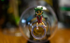 why am I sittin' on a Bottleneck? (Dotsy McCurly) Tags: girl yotsuba arttoy bottle bottleneck smileonsaturday tabletop handheld tokinaatxm100prod100mmf28macro nikonz7