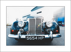 An Armstrong Siddeley outside Rolls-Royce (G. Postlethwaite esq.) Tags: armstrongsiddeley canon40d derby derbyshire sigma1020mm building car classicvehicle headlights indicators outdoor photoborder radiatorgrill wideangle