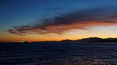 Ciel matinal d'Île-Rousse (AdminOfPlaygroup) Tags: ciel mer nuage aube bateau ferry noir orange corse ilerousse
